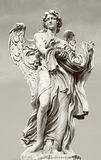 Rome - Angel with garment and dice by Paolo Naldini (1619–1691) Royalty Free Stock Photos