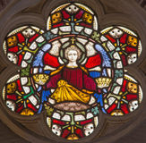 Rome - The angel with the symbolic crowns on the stained glass rosette of All Saints` Anglican Church by workroom Clayton and Hall. ROME, ITALY - MARCH 9. 2016 stock photos