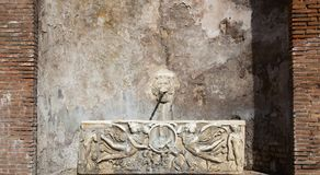 Rome antic Fountain. Antic Fountain In Rome With Lion Head and Angels Stock Photo