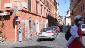 Rome, Apr 25th 2020: Woman with mask in deserted streets during covid lockdown