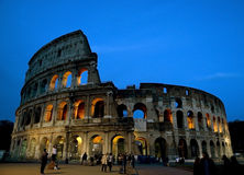 ROME - APRIL 18: Coliseum exterior on April 18, 2015 in Rome, Italy. The Coliseum is one of Rome's most popular tourist attraction Royalty Free Stock Photos
