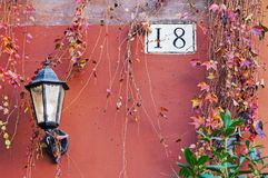 Rome architecture detail with street lamp and house number. Rome architecture detail with street lamp, house number plate and autumn plants Stock Images
