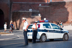 ROME-AUGUST 8: Italian Police patrol on Via dei Fori Imperiali on August 8,2013 in Rome. Stock Photos