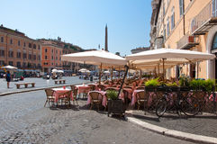 ROME-AUGUST 8: Restaurant on the Piazza Navona on August 8, 2013 in Rome. Royalty Free Stock Image