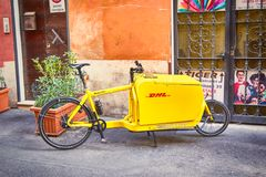 Bicycle from delivery firm -  DHL on Italian streets August 4, 2. ROME - AUGUST 4: Bicycle from delivery firm -  DHL on Italian streets August 4, 2017 in Rome Stock Image