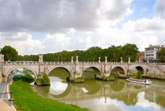 Rome: Banks of the Tiber. Bernini?s white marble angels on the Ponte Sant?Angelo and the Ponte Vittorio Emanuelle II reflecting in the River Tiber as is runs stock photo