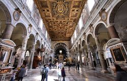 Rome basilica. ROME - APRIL 8: People visit Basilica Santa Maria in Aracoeli on April 8, 2012 in Rome. The famous romanesque church dates back to 12th century Stock Photo