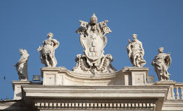 Rome - Bernini colonnade - papal heraldry Stock Images