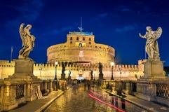 Rome, the bridge of St. Angelo, night landscape. View of the Castle of St. Angelo, the bridge with the same name Royalty Free Stock Photos
