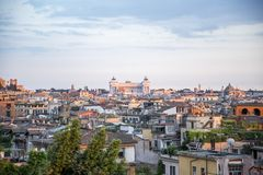 Rome at sunset seen from the hill. Rome, the capital of Italy, at sunset seen from the hill royalty free stock image