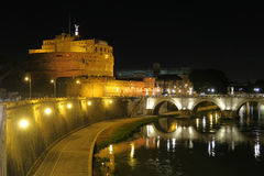 Rome Castel SantAngelo night view with St. Angelo Bridge on Tiber river. Ponte SantAngelo pedestrian bridge in Rome Italy summer view royalty free stock photo