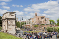Rome central archaeological area. Tourists visit Rome central archaeological area with Arch of  Constantine and ancient Temple of Venus and Roma ruins Royalty Free Stock Photos