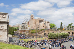 Rome central archaeological area. Tourists visit Rome central archaeological area with Arch of  Constantine and ancient Temple of Venus and Roma ruins Stock Images