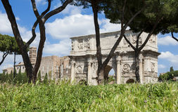 Rome central archeological area. Arch of Constantine and Temple of Venus ancient ruins with green grass, in the historic center of Rome Stock Photos