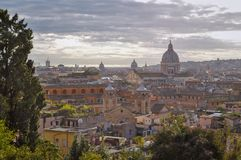 Rome city skyline after rain. Church and towers in background with cloudy sky. stock photos