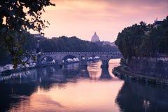 Rome cityscape with bridge over Tiber river. Rome cityscape with old bridge over Tiber river in evening Stock Photos