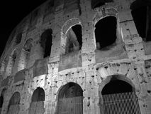 Rome Colloseum in Black and White. Photo of the colosseum in rome italy at night in black and white. The colosseum was completed in 80 ad and ready for many royalty free stock images
