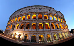 Rome Colosseum illuminated at night Stock Images