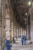 Rome Colosseum inre korridor med turister Fotografering för Bildbyråer