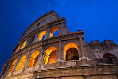 Rome Colosseum at night with lights on. The world famous Colosseum in Rome Royalty Free Stock Photos