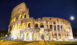Rome Colosseum by Night. Picture of the Colosseum in Rome, Italy, in the evening with full moon Royalty Free Stock Photo