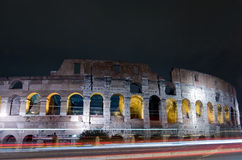 Rome Colosseum night scene. In Italy with traffic lights Stock Image