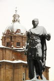 Rome covered by snow. A really rare event in Rome. Here the bronze statue of a Roman Emperor in front of a Church stock photography