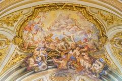 Rome - de plafondfresko van de Val van de Rebelious-Engelen in dei Santi XII van de kerkbasiliek Apostoli Royalty-vrije Stock Foto's