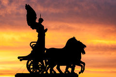 Rome at dusk: silhouette of the goddess Victoria. Royalty Free Stock Photo
