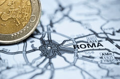 Rome and Euro coin. Concept studio shot depicting current economic issues surrounding the Italian economy and the Euro Stock Images