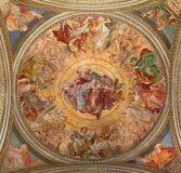 Rome -The Father Adored the Heavenly Host fresco  on the ceiling in side chapel of St Francis in Basilica di Santa Maria in Tras Royalty Free Stock Photo