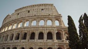 ROME - FEB 20: Famous tourist attraction Colosseum in summer, February 20, 2018. ROME - FEB 20: Famous tourist attraction Roman Colosseum Coliseum Flavian stock video