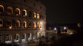 ROME - FEB 20: View of Colosseum at night, February 20, 2018. ROME - FEB 20: Roman Colosseum Coliseum Flavian Amphitheatre Anfiteatro Flavio Colosseo, an oval stock footage