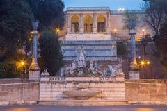 Rome - The Fontana del Nettuno by Giovanni Ceccarini 1822 - 1823 on Piazza del Popolo. At dusk royalty free stock photo