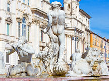 Rome - The fountain Fontana del Moro by Giacomo della Porta on Piazza on Navona and baroque Santa Agnese in Agone church. Royalty Free Stock Image