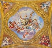Rome - The fresco of virtues on the little cupola of side nave in church Basilica dei Santi Ambrogio e Carlo al Corso Stock Images
