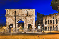 Rome Gate Coliseum Rise. Constantine triumphal arch gate near ruins of Rome Coliseum in Italy at sunrise. Tourist attraction and landmarks illuminated at sunrise Royalty Free Stock Photos
