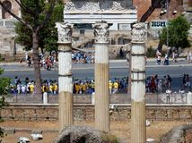 Rome - Group of tourists at the Fori Imperiali. Rome, Lazio, Italy - April 20, 2017: Group of tourists at the Fori Imperiali seen from the Capitol Gardens Royalty Free Stock Photography