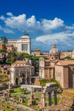 Rome historic center skyline above Roman Forum. Ancient ruins, classical monuments and baroque church in the historic center of Rome with copy space above Stock Photography