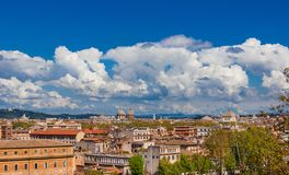 Rome historic center skyline above Trastevere. Rome historic center old skyline above Trastevere with old churches, belltowers, domes and clouds, seen from stock image