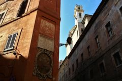 Rome historic centre: papal inscription and icon royalty free stock photos