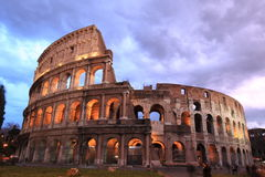 Rome: illuminated Colosseum at twilight Stock Photos