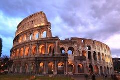 Rome: illuminated Colosseum at twilight Stock Photos