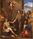 ROME, ITALIE - 9 MARS 2016 : St Anthony de peinture de Padoue élève un homme de la mort photo libre de droits