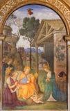 ROME ITALIEN: FreskomålningKristi födelse med Stet Jerome i det Rovere kapellet i kyrkliga basilikadi Santa Maria del Popolo Royaltyfri Bild