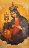 ROME ITALIEN: Madonna med barnsymbolen i kyrkliga basilikadi Santa Maria del Popolo vid A Raggi Royaltyfri Foto