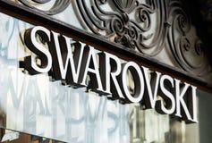 Rome Italien - Maj 13, 2018: Swarovski logo på lager för märkes` s i Rome Royaltyfria Bilder