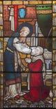 ROME ITALIEN - MARS 9 2016: Ananiasen som allra återställer sikt till Saul på för helgon` för målat glass den anglikanska kyrkan Arkivbild
