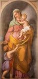 ROME ITALIEN - MARS 11, 2016: Den symboliska freskomålningen av förälskelse som den huvudsakliga förtjänsten i kyrkliga basilikad Royaltyfri Fotografi