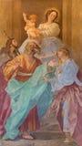 ROME ITALIEN - MARS 12, 2016: Freskomålningen av Madonna med helgonen i den kyrkliga Chiesa diSanta Maria dellen Orto av Giovanni Arkivbild